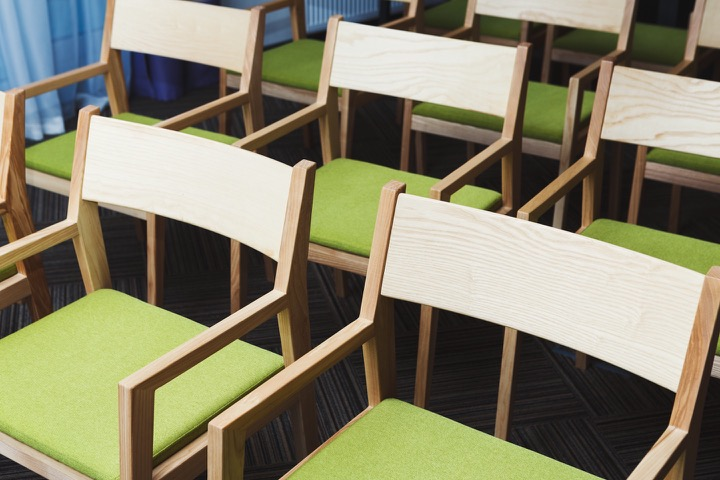 Green chairs at conference